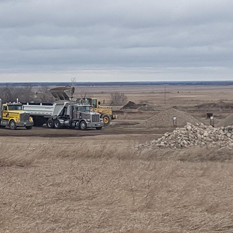 Trucks and loader at aggregates yard